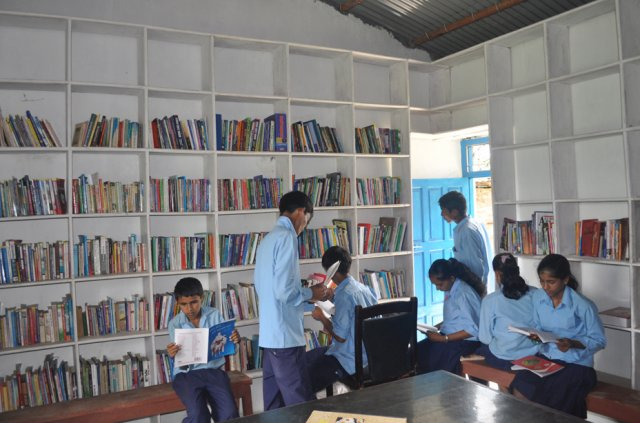 Dharapani students going through the newly organized books image