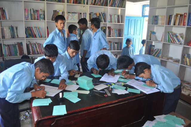 Students of Dharapani helping out with the coding during their lunch break image
