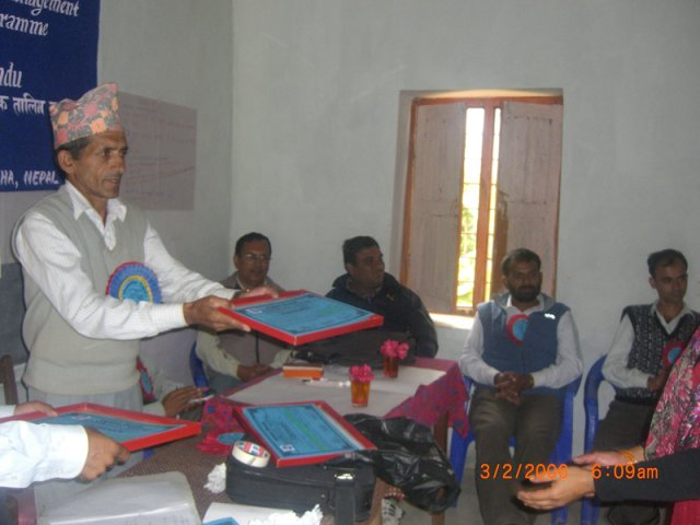 The Deputy Education Officer of Gorkha distributing certificates to the particpants
