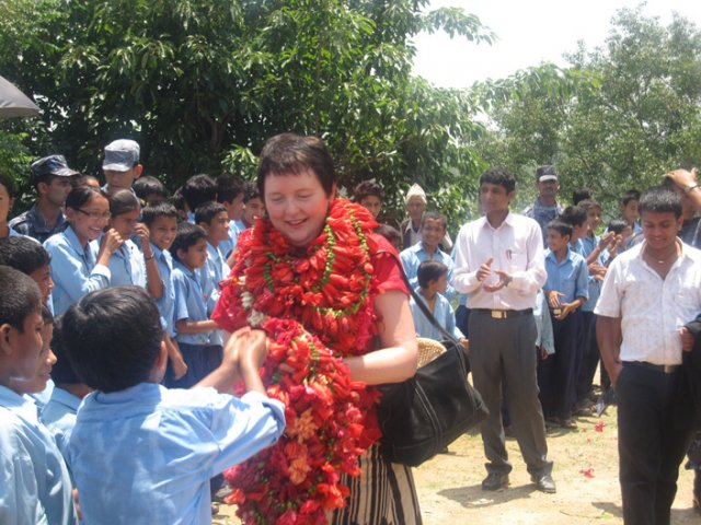 The Student Offering Garland to the Ambassador