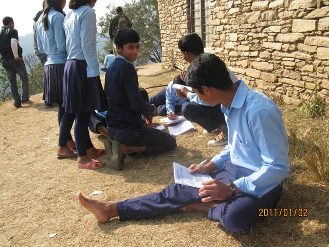Students studying outside in the pleasant sun