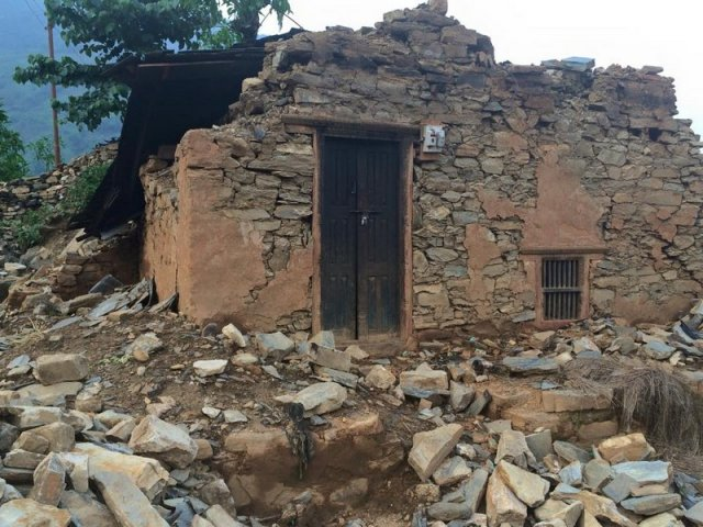 A collapsed house in Aprik village