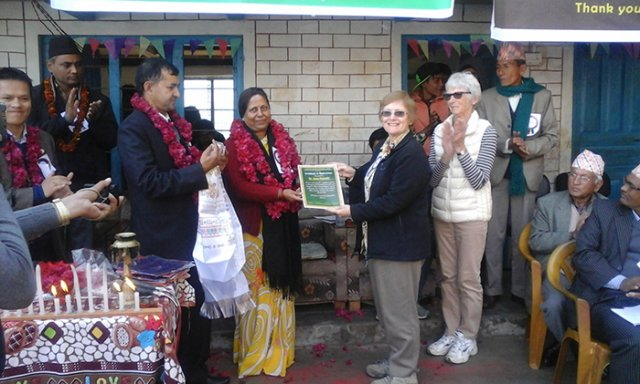 Education Minister Handing Certificate of Appreciation to Australian Volunteer