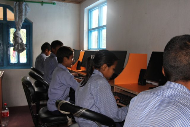 Students checking the computers