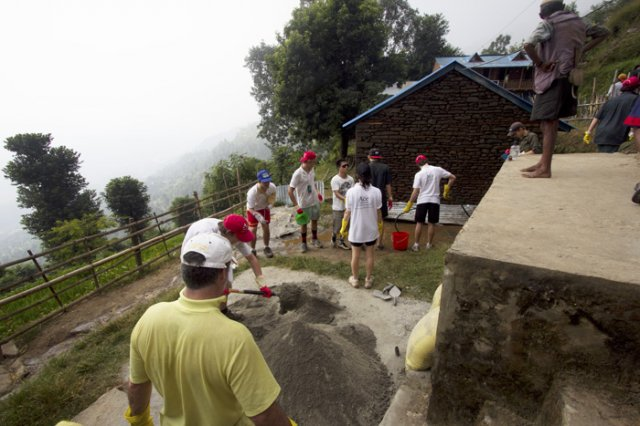 Volunteer preparing the cement