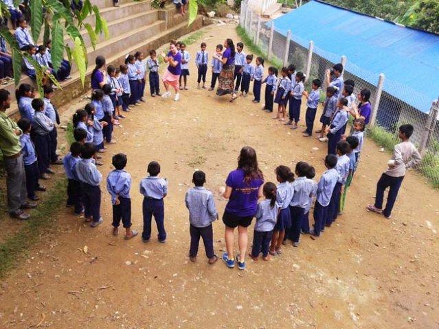 Volunteer teaching kids some games