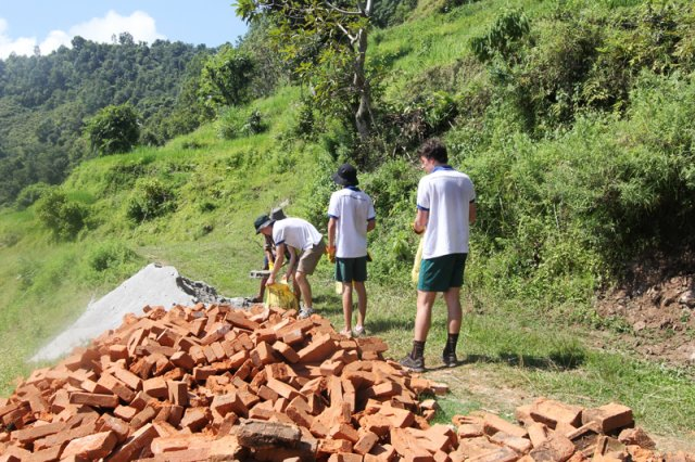 Volunteers carrying the Bricks up to the site